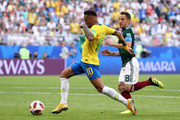 Neymar Jr of Brazil gets away from Andres Guardado of Mexico on his way to setting up Brazil's second goal during the 2018 FIFA World Cup Russia Round of 16 match between Brazil and Mexico at Samara Arena on July 2, 2018 in Samara, Russia.