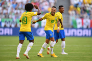 Neymar Jr of Brazil celebrates with teammate Willian after scoring his team's first goal during the 2018 FIFA World Cup Russia Round of 16 match between Brazil and Mexico at Samara Arena on July 2, 2018 in Samara, Russia.