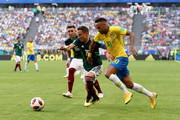 Neymar Jr of Brazil challenge for the ball with Hector Herrera and Hector Herrera of Mexico  during the 2018 FIFA World Cup Russia Round of 16 match between Brazil and Mexico at Samara Arena on July 2, 2018 in Samara, Russia.