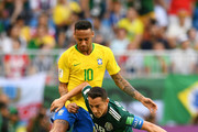 Andres Guardado of Mexico is challenged by Neymar Jr of Brazil during the 2018 FIFA World Cup Russia Round of 16 match between Brazil and Mexico at Samara Arena on July 2, 2018 in Samara, Russia.