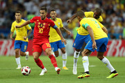 Eden Hazard of Belgium runs with the ball under pressure from Miranda of Brazil during the 2018 FIFA World Cup Russia Quarter Final match between Brazil and Belgium at Kazan Arena on July 6, 2018 in Kazan, Russia.