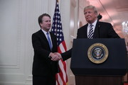 U.S. Supreme Court Justice Brett Kavanaugh shakes hands with President Donald Trump, at a Kavanaugh's ceremonial swearing in in the East Room of the White House October 08, 2018 in Washington, DC. Kavanaugh was confirmed in the Senate 50-48 after a contentious process that included several women accusing Kavanaugh of sexual assault. Kavanaugh has denied the allegations.