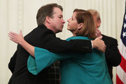 U.S. Supreme Court Associate Justice Brett Kavanaugh embraces his wife Ashley Kavanaugh after his ceremonial swearing in in the East Room of the White House October 08, 2018 in Washington, DC. Kavanaugh was confirmed in the Senate 50-48 after a contentious process that included several women accusing Kavanaugh of sexual assault. Kavanaugh has denied the allegations.