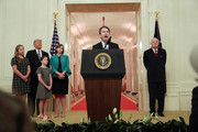 U.S. Supreme Court Justice Brett Kavanaugh speaks at his ceremonial swearing in as retired Justice Anthony Kennedy (R), President Donald Trump, Kavanaugh's wife Ashley, youngest daughter Liza and oldest daughter Margaret look on in the East Room of the White House October 08, 2018 in Washington, DC. Kavanaugh was confirmed in the Senate 50-48 after a contentious process that included several women accusing Kavanaugh of sexual assault. Kavanaugh has denied the allegations.