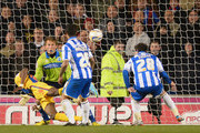 Wilfried Zaha of Crystal Palace heads past Tomasz Kuszczak of Brighton to score during the npower Championship Play Off Semi Final Second Leg between Brighton & Hove Albion and Crystal Palace at Amex Stadium on May 13, 2013 in Brighton, England.