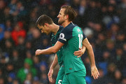 Harry Kane of Tottenham Hotspur celebrates with Jan Vertonghen of Tottenham Hotspur after he scores his sides first goal from the penalty spot during the Premier League match between Brighton & Hove Albion and Tottenham Hotspur at American Express Community Stadium on September 22, 2018 in Brighton, United Kingdom.