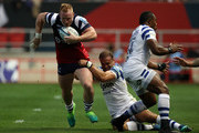 Will Hurrell of Bristol Bears is tackled by Jamie Roberts of Bath Rugby during the Gallagher Premiership Rugby match between Bristol Bears and Bath Rugby at Ashton Gate on August 31, 2018 in Bristol, United Kingdom.
