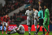 Paul Pogba of Manchester United is booked by referee Mike Dean during the Carabao Cup Quarter-Final match between Bristol City and Manchester United at Ashton Gate on December 20, 2017 in Bristol, England.