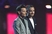 Best British Female Solo Artist award presenters Liam Payne and Louis Tomlinson on stage at the BRIT Awards 2016 at The O2 Arena on February 24, 2016 in London, England.