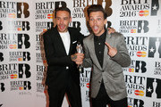 Liam Payne and Louis Tomlinson from One Direction with their British Artist Video of the Year award at the BRIT Awards 2016 at The O2 Arena on February 24, 2016 in London, England.