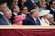 President of the United States, Donald Trump and First Lady of the United States, Melania Trump sit next to Prince Charles, Prince of Wales, Queen Elizabeth II and President of Greece, Prokopis Pavlopoulos (R) as they attend the D-Day Commemorations on June 5, 2019 in Portsmouth, England. The political heads of 16 countries involved in World War II joined Her Majesty, The Queen on the UK south coast for a service to commemorate the 75th anniversary of D-Day. Overnight it was announced that all 16 had signed a historic proclamation of peace to ensure the horrors of the Second World War are never repeated. The text has been agreed by Australia, Belgium, Canada, Czech Republic, Denmark, France, Germany, Greece, Luxembourg, Netherlands, Norway, New Zealand, Poland, Slovakia, the United Kingdom and the United States of America.