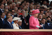 President of the United States, Donald Trump and First Lady of the United States, Melania Trump listen as Queen Elizabeth II gives an address during the D-Day Commemorations on June 5, 2019 in Portsmouth, England. The political heads of 16 countries involved in World War II joined Her Majesty, The Queen on the UK south coast for a service to commemorate the 75th anniversary of D-Day. Overnight it was announced that all 16 had signed a historic proclamation of peace to ensure the horrors of the Second World War are never repeated. The text has been agreed by Australia, Belgium, Canada, Czech Republic, Denmark, France, Germany, Greece, Luxembourg, Netherlands, Norway, New Zealand, Poland, Slovakia, the United Kingdom and the United States of America.