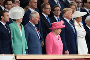 President of the United States, Donald Trump and First Lady of the United States, Melania Trump stand next to British Prime minister, Theresa May, Prince Charles, Prince of Wales, Queen Elizabeth II as they attend the D-Day Commemorations on June 5, 2019 in Portsmouth, England. The political heads of 16 countries involved in World War II joined Her Majesty, The Queen on the UK south coast for a service to commemorate the 75th anniversary of D-Day. Overnight it was announced that all 16 had signed a historic proclamation of peace to ensure the horrors of the Second World War are never repeated. The text has been agreed by Australia, Belgium, Canada, Czech Republic, Denmark, France, Germany, Greece, Luxembourg, Netherlands, Norway, New Zealand, Poland, Slovakia, the United Kingdom and the United States of America.