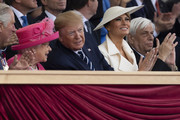 President of the United States, Donald Trump and First Lady of the United States, Melania Trump sit next to Prince Charles, Prince of Wales, Queen Elizabeth II as they attend the D-Day Commemorations on June 5, 2019 in Portsmouth, England. The political heads of 16 countries involved in World War II joined Her Majesty, The Queen on the UK south coast for a service to commemorate the 75th anniversary of D-Day. Overnight it was announced that all 16 had signed a historic proclamation of peace to ensure the horrors of the Second World War are never repeated. The text has been agreed by Australia, Belgium, Canada, Czech Republic, Denmark, France, Germany, Greece, Luxembourg, Netherlands, Norway, New Zealand, Poland, Slovakia, the United Kingdom and the United States of America.