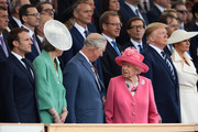 President of the United States, Donald Trump and First Lady of the United States, Melania Trump stand next to President of the France, Emmanuel Macron (L) British Prime minister, Theresa May, Prince Charles, Prince of Wales and Queen Elizabeth II as they attend the D-Day Commemorations on June 5, 2019 in Portsmouth, England. The political heads of 16 countries involved in World War II joined Her Majesty, The Queen on the UK south coast for a service to commemorate the 75th anniversary of D-Day. Overnight it was announced that all 16 had signed a historic proclamation of peace to ensure the horrors of the Second World War are never repeated. The text has been agreed by Australia, Belgium, Canada, Czech Republic, Denmark, France, Germany, Greece, Luxembourg, Netherlands, Norway, New Zealand, Poland, Slovakia, the United Kingdom and the United States of America.