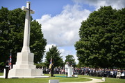 British Prime Minister Theresa May delivers a speech during the Royal British Legion Service of Remembrance at the Commonwealth War Graves Cemetery on June 6, 2019 in Bayeux, France. Veterans and families gathered in Normandy to commemorate D-Day's 75th anniversary. It has been announced that 16 countries had signed a historic proclamation of peace to ensure the horrors of the Second World War are never repeated. The text has been agreed by Australia, Belgium, Canada, Czech Republic, Denmark, France, Germany, Greece, Luxembourg, Netherlands, Norway, New Zealand, Poland, Slovakia, the United Kingdom and the United States of America.