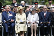 (L-R) Britan's Charles, Prince of Wales, Camilla, Duchess of Cornwall, British Prime Minister Theresa May and Philip May watch the Royal British Legion Service of Remembrance at the Commonwealth War Graves Cemetery on June 6, 2019 in Bayeux, France. Veterans and families gathered in Normandy to commemorate D-Day's 75th anniversary. It has been announced that 16 countries had signed a historic proclamation of peace to ensure the horrors of the Second World War are never repeated. The text has been agreed by Australia, Belgium, Canada, Czech Republic, Denmark, France, Germany, Greece, Luxembourg, Netherlands, Norway, New Zealand, Poland, Slovakia, the United Kingdom and the United States of America.