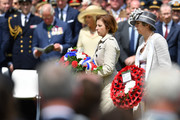 French Minister of the Armed Forces Florence Parly and British Prime Minister, Theresa May lay wreaths at a memorial service in Bayeux Cemetery on June 06, 2019 in Bayeux, France. Veterans and families gathered in Normandy to commemorate D-Day's 75th anniversary. It has been announced that 16 countries had signed a historic proclamation of peace to ensure the horrors of the Second World War are never repeated. The text has been agreed by Australia, Belgium, Canada, Czech Republic, Denmark, France, Germany, Greece, Luxembourg, Netherlands, Norway, New Zealand, Poland, Slovakia, the United Kingdom and the United States of America.