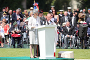Britain's Prime Minister, Theresa May makes a speech at a memorial service at Bayeux War Cemetery on June 06, 2019 in Bayeux, France. Veterans, families, visitors, political leaders and military personnel are gathering in Normandy to commemorate D-Day, which heralded the Allied advance towards Germany and victory about 11 months later.