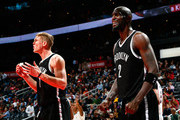 Kevin Garnett #2 and Mason Plumlee #1 of the Brooklyn Nets react after a foul was called on Garnett against the Atlanta Hawks at Philips Arena on January 28, 2015 in Atlanta, Georgia.  NOTE TO USER: User expressly acknowledges and agrees that, by downloading and or using this photograph, User is consenting to the terms and conditions of the Getty Images License Agreement.