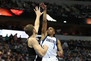 Dennis Smith Jr. #1 of the Dallas Mavericks takes a shot against Tyler Zeller #44 of the Brooklyn Nets in the second half at American Airlines Center on November 29, 2017 in Dallas, Texas.  NOTE TO USER: User expressly acknowledges and agrees that, by downloading and or using this photograph, User is consenting to the terms and conditions of the Getty Images License Agreement.