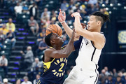 Darren Collison #2 of the Indiana Pacers and Jeremy Lin #7 of the Brooklyn Nets battle for a loose ball at Bankers Life Fieldhouse on October 18, 2017 in Indianapolis, Indiana.  NOTE TO USER: User expressly acknowledges and agrees that, by downloading and or using this photograph, User is consenting to the terms and conditions of the Getty Images License Agreement.
