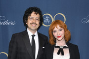 Geoffrey Arend (L) and Christina Hendricks attend the Brooks Brothers Bicentennial Celebration at Jazz At Lincoln Center on April 25, 2018 in New York City.