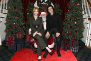 (L-R) Christina Hendricks, Santa Claus, and Geoffrey Arend attend an evening hosted by Brooks Brothers to celebrate the holidays with St. Jude Children's Research Hospital at Brooks Brothers on December 13, 2016 in New York City.