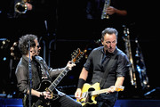 Nils Lofgren and Bruce Springsteen perform at Madison Square Garden on April 6, 2012 in New York City.