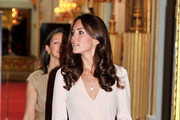 Catherine, Duchess of Cambridge views the exhibitions for the summer opening of Buckingham Palace on July 22, 2011 in London, England. The Duchess of Cambridge's intricately decorated wedding dress, designed by Sarah Burton of Alexander McQueen is currently on display at Buckingham Palace