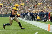 Jimmy Graham #80 of the Green Bay Packers scores a touchdown during the first quarter of a game against the Buffalo Bills at Lambeau Field on September 30, 2018 in Green Bay, Wisconsin.