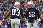 Tom Brady #12 of the New England Patriots and Dwayne Allen #83 celebrate during the game against the Buffalo Bills Gillette Stadium on December 24, 2017 in Foxboro, Massachusetts.