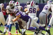Chris Ivory #33 of the Buffalo Bills is tackled with the ball by Tashawn Bower #90 of the Minnesota Vikings in the fourth quarter of the game at U.S. Bank Stadium on September 23, 2018 in Minneapolis, Minnesota.