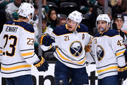 Kyle Okposo #21 of the Buffalo Sabres celebrates his goal with Sam Reinhart #23 and Conor Sheary #43 to trail 2-1 to the Anaheim Ducks during the second period at Honda Center on October 21, 2018 in Anaheim, California.