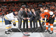 Former Philadelphia Flyer Danny Briere along with his sons Caelan Briere,Carson Briere and Cameron Briere drop the puck in a ceremony with Buffalo Sabres captain Brian Gionta #12 and Flyers captain Claude Giroux #28 before the game on October 27, 2015 at the Wells Fargo Center in Philadelphia, Pennsylvania.