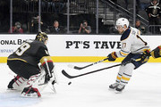 Vladimir Sobotka #17 of the Buffalo Sabres shoots a rebound through the five-hole of Marc-Andre Fleury #29 of the Vegas Golden Knights in the third period of their game at T-Mobile Arena on October 16, 2018 in Las Vegas, Nevada. The Golden Knights defeated the Sabres 4-1.
