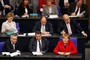 Cabinet members sit on the government's bench and attend a session at the Bundestag (lower house of parliament) on November 21, 2017 in Berlin (front row, L-R): German Interior Minister Thomas de Maiziere, German Vice Chancellor and Foreign Minister Sigmar Gabriel and German Chancellor Angela Merkel; (second row, L-R): German Defence Minister Ursula von der Leyen, German Agriculture Minister Christian Schmidt and German Chief of Staff and interim Finance Minister Peter Altmaier. / AFP PHOTO / Odd ANDERSEN