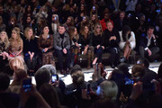 (L-R) Lily Donaldson, Paloma Faith, Clemence Posey, Maggie Gyllenhaal, Sam Smith, Cara Delevingne, Jourdan Dunn, Kate Moss, Mario Testino and Naomi Campbell attend the Burberry Prorsum AW 2015 show during London Fashion Week at Kensington Gardens on February 23, 2015 in London, England.