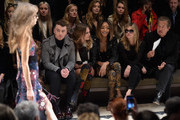 (L-R) Sam Smith, Cara Delevingne, Jourdan Dunn, Kate Moss and Mario Testino attend the Burberry Prorsum AW 2015 show during London Fashion Week at Kensington Gardens on February 23, 2015 in London, England.