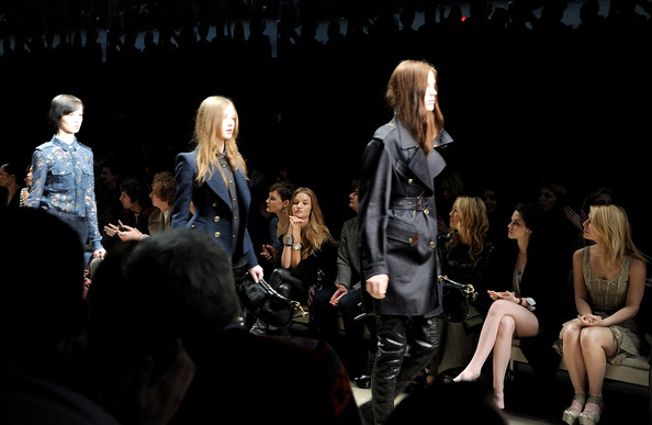 Rosie Hunington-Whiteley, Mary-Kate Olsen, Kate Hudson and Kristen Stewart watch the runway attends the Burberry Prorsum LFW Autumn/Winter 2010 Women?s wear show at the Parade Ground, Chelsea College of Art on February 23, 2010 in London, England.