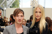 Dan Gillespie (L) and Poppy Delevingne attend at the Burberry Spring Summer 2012 Womenswear Show at Kensington Gardens on September 19, 2011 in London, England.