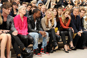 (L to R) Dan Gillespie, Ellie Goulding, Kanye West, Sienna Miller, Gemma Arterton, Rosie Huntington-Whiteley, Mario Testino, and Andy Murray attend at the Burberry Spring Summer 2012 Womenswear Show at Kensington Gardens on September 19, 2011 in London, England.