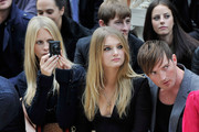 Poppy De Villeneuve, Lily Donaldson and Dan Gillespie attend the Burberry Spring Summer 2012 Womenswear Show at Kensington Gardens on September 19, 2011 in London, England.