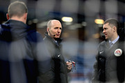 Match referee, Mike Dean in conversation prior to the Premier League match between Burnley and Tottenham Hotspur at Turf Moor on December 23, 2017 in Burnley, England.
