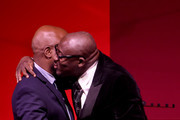 Duro Olowu (L) presents Edward Enninful with the Global VOICES Award 2019, during the gala dinner at #BoFVOICES on November 22, 2019 in Oxfordshire, England.