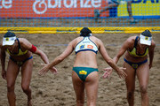 (L-R) Juliana, Agatha and Maria Eliza, in action during theCBBVP Open Beach Volleyball - Finalat Enseada Beach on November 17, 2013 in Guaruja, Brazil. (Photo by Rafael Neddermeyer/Getty Images)