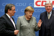 (L to R) The Christian Democratic Union (CDU) party's state leader in North Rhine-Westphalia Armin Laschet, German chancellor Angela Merkel (CDU), and State Premier of Hessen and CDU party member Volker Bouffier arrive for a party meeting at the German Christian Democrat (CDU) headquarters on January 21, 2018 in Berlin, Germany. Delegates from the country's Social Democratic Party (SPD) voted earlier in the day at a party conference in Bonn to begin negotiations into a possible coalition with Merkel's conservatives.