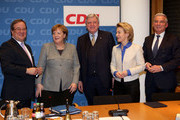 (L to R) The Christian Democratic Union (CDU) party's state leader in North Rhine-Westphalia Armin Laschet, German chancellor Angela Merkel (CDU), State Premier of Hessen and CDU party member Volker Bouffier, Minister of Defense Ursula von der Leyen (CDU), and Thomas Strobl, chairman of the CDU in Baden-Wuerttemberg, arrive for a party meeting at the German Christian Democrat (CDU) headquarters on January 21, 2018 in Berlin, Germany. Delegates from the country's Social Democratic Party (SPD) voted earlier in the day at a party conference in Bonn to begin negotiations into a possible coalition with Merkel's conservatives.
