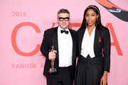 Brandon Maxwell poses with the Womenswear Designer of the Year Award and Jessica Williams during Winners Walk during the CFDA Fashion Awards at the Brooklyn Museum of Art on June 03, 2019 in New York City.