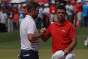 Marc Leishman of Australia shakes hands with Gary Woodland of United States on the 18th hole during the final round of the CIMB Classic at TPC Kuala Lumpur on October 14, 2018 in Kuala Lumpur, Malaysia.